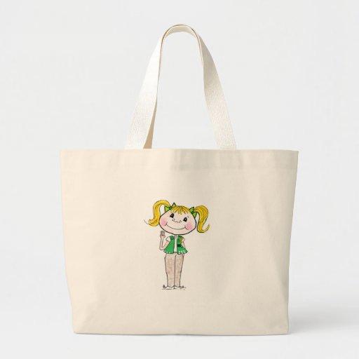 Joven del girl scout que guarda la promesa bolsas