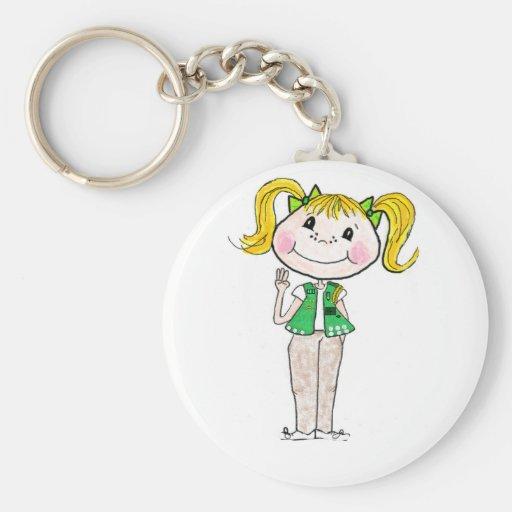 Joven del girl scout que guarda la promesa llaveros personalizados