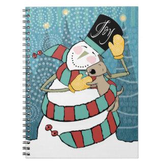 Joyful Holiday Snowman Wraps Puppy in Scarf Spiral Notebooks