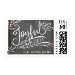 Joyful Wish   Personalized Postage<br><div class='desc'>Beautiful typography based Christmas postage stamp features &quot;Joyful Wishes&quot; in white hand lettered typography on a charcoal gray chalkboard background accented with white sketched leaves and red holly berries. Customize with your family name for a unique custom addition to your holiday mailings.</div>