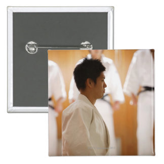 Judo Master Kneeling On a Mat Pinback Button