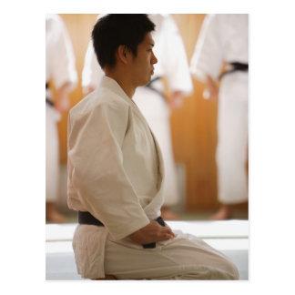 Judo Master Kneeling On a Mat Postcard