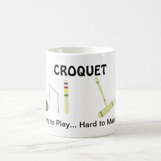 Juego del croquet con decir taza de café