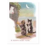 Juego musical de los gatos por Año Nuevo del Postales