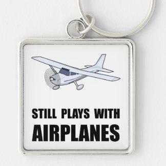 Juegos con los aeroplanos llavero cuadrado plateado