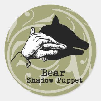 Juegos de la sombra de la marioneta de mano del pegatina redonda