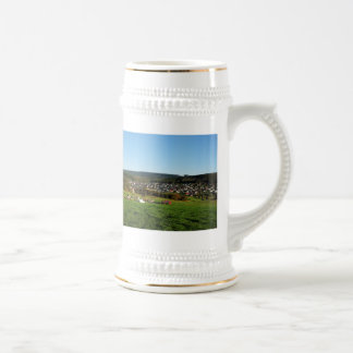 Jug autumn in the winner country with village beer stein