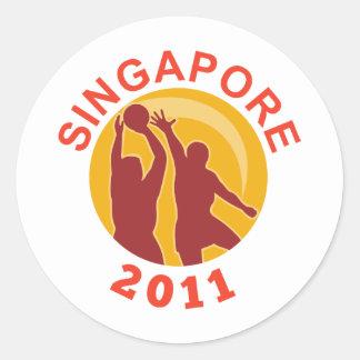 Jugador 2011 de Singapur del Netball que pasa la Etiquetas Redondas
