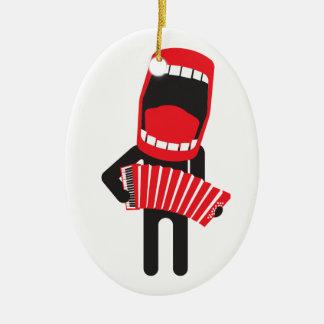 jugador cantante ruidoso del acordeón adorno navideño ovalado de cerámica