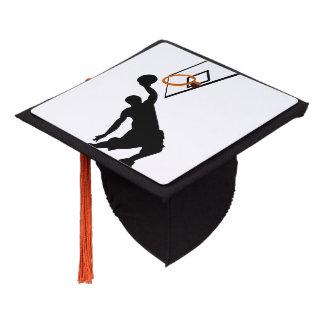 Jugador de básquet de la clavada de la silueta