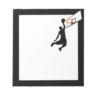 Jugador de básquet de la clavada de la silueta bloc de notas