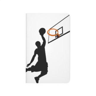 Jugador de básquet de la clavada de la silueta cuaderno grapado