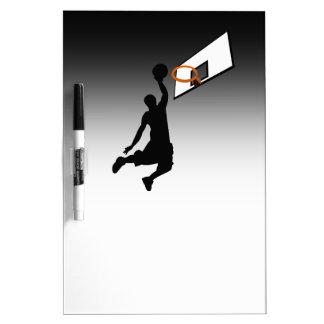 Jugador de básquet de la clavada de la silueta pizarras blancas