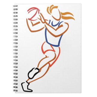 Jugador de básquet de sexo femenino spiral notebooks