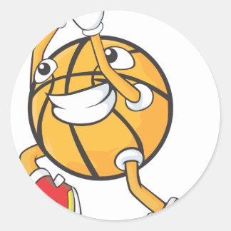 Jugador de básquet feliz que hace un tiro pegatina redonda