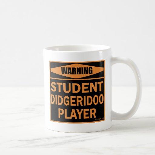 Jugador de Didgeridoo del estudiante Taza