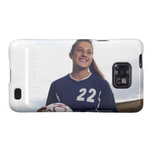 jugador de fútbol adolescente del chica que celebr galaxy SII carcasa
