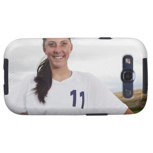 jugador de fútbol adolescente sonriente del chica  galaxy SIII coberturas