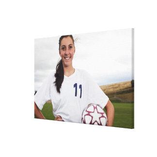 jugador de fútbol adolescente sonriente del chica  impresión en lienzo estirada