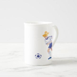 Jugador de fútbol de sexo femenino taza de china
