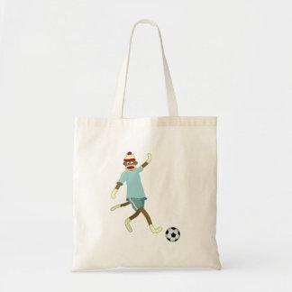 Jugador de fútbol del mono del calcetín bolsa