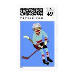 Jugador de hockey del mono del calcetín sellos