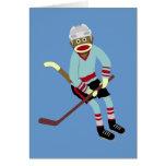 Jugador de hockey del mono del calcetín felicitación