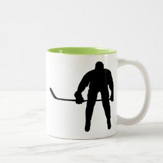 Jugador de hockey fresco tazas de café