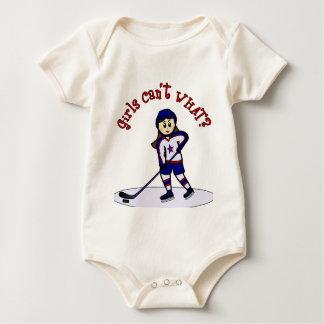 Jugador de hockey ligero de los chicas enteritos