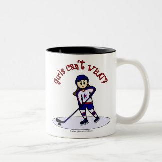 Jugador de hockey ligero de los chicas taza