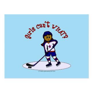 Jugador de hockey oscuro de los chicas postales