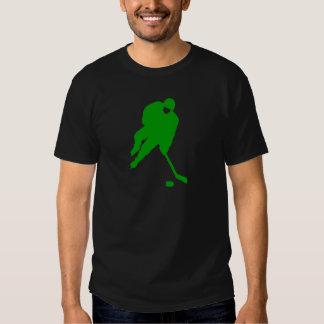 Jugador de hockey verde camisas