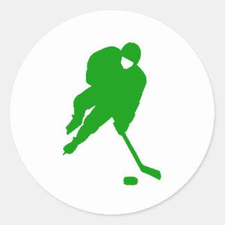 Jugador de hockey verde pegatina redonda