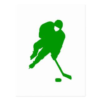 Jugador de hockey verde postal
