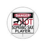 Jugador de saxofón caliente del soprano relojes de pared