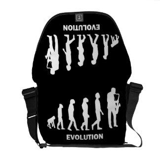jugador de saxofón de la evolución bolsas de mensajería