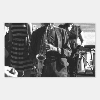 Jugador de saxofón pegatina rectangular