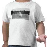Jugador de tenis de la mujer que consigue la camiseta
