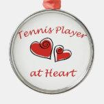 Jugador de tenis en el corazón adorno de reyes
