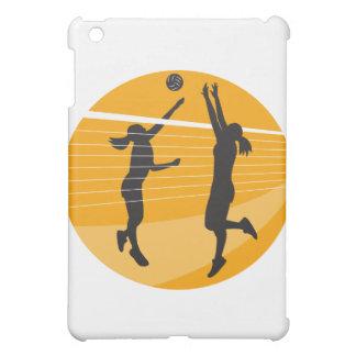 Jugador de voleibol que clava bloqueando la bola i