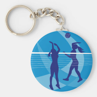 Jugador de voleibol que clava bloqueando la bola i llavero