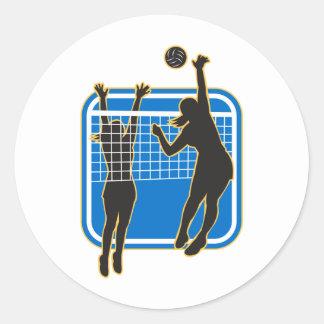 Jugador de voleibol que clava bloqueando la bola i pegatinas