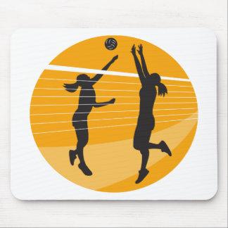 Jugador de voleibol que clava bloqueando la bola i tapetes de ratones