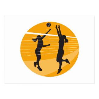 Jugador de voleibol que clava bloqueando la bola i tarjeta postal