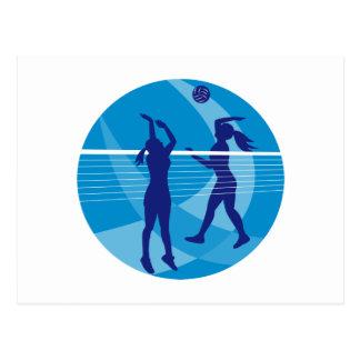 Jugador de voleibol que clava bloqueando la bola i postal