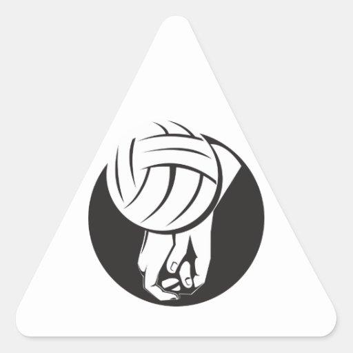 Jugador de voleibol que golpea la bola pegatina triangular