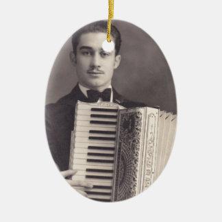 Jugador del acordeón del vintage adorno navideño ovalado de cerámica