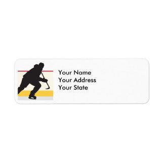 jugador del hockey sobre hielo en el movimiento etiquetas de remite