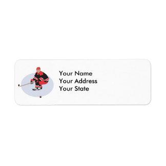 jugador del hockey sobre hielo listo para pegar etiqueta de remitente
