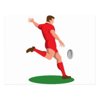 jugador del rugbi que golpea la bola con el pie tarjetas postales